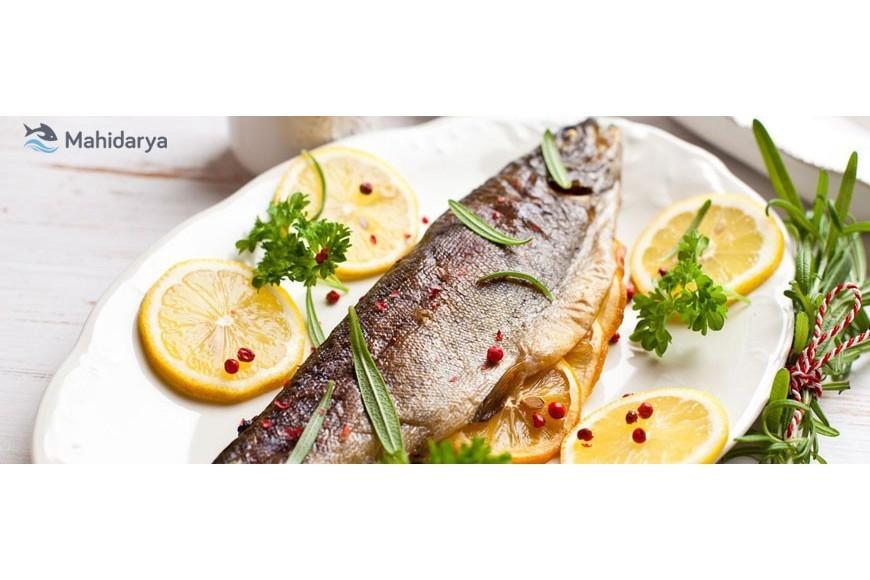 راز درست کردن یک ماهی شکم پر خوشمزه در فر چیست ؟